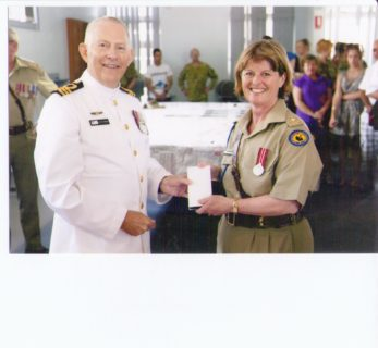 Diane receiving Cadets WA State 10 Year Medal from Geoff Hurren